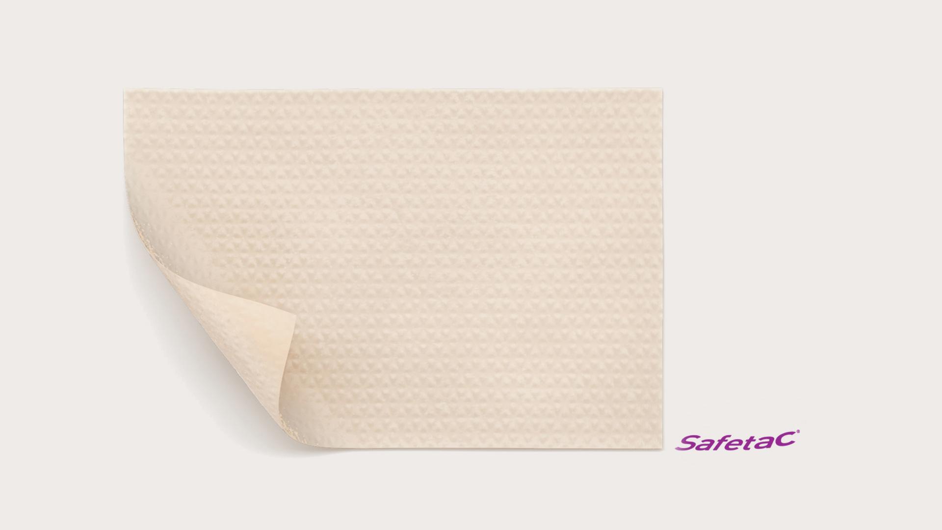 Self-adherent dressing for scar management with Safetac